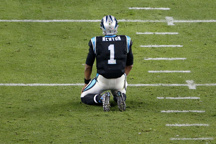 Carolina Panthers quarterback Cam Newton kneels on the field after fumbling in the fourth quarter against the Denver Broncos in Super Bowl 50 at Levi's Stadium in Santa Clara, Calif. Newton was sacked six times and fumbled twice. Photo: Aj Mast /New York Times / NYTNS
