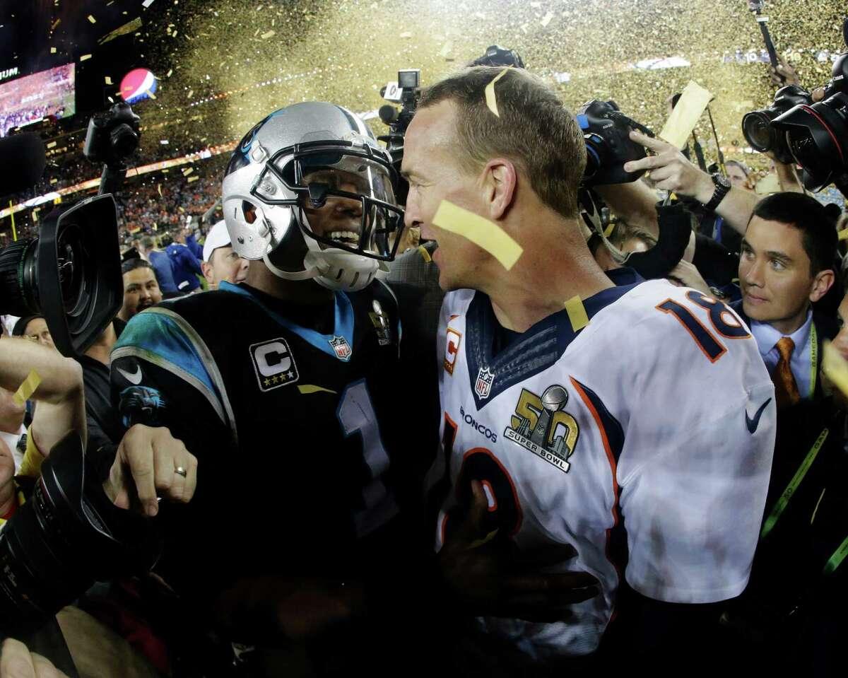 Denver Broncos' Peyton Manning greets Carolina Panthers' Cam Newton after Super Bowl 50 on Feb. 7, 2016, in Santa Clara, Calif. The Broncos won 24-10.