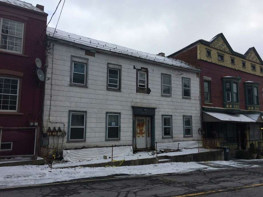 A blighted house at 84 Main St., Coeymans, as seen on Jan. 13, 2016. Port of Coeymans owner Carver Laraway bought the house from the town for $250 after he agreed to tear it down. But in February 2016, the state Labor Department shut the demolition down because Carver Construction is not on a list of certified demolition companies. (Lauren Stanforth)