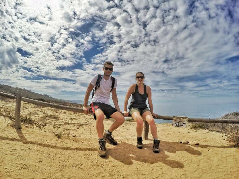 Justina and Christina Greak, of Kingwood, take a rest during a hike in La Jolla, Calif., 2015. The couple have released a video of panoramic selfies condensing two years of travel into three minutes. (Courtesy photo)