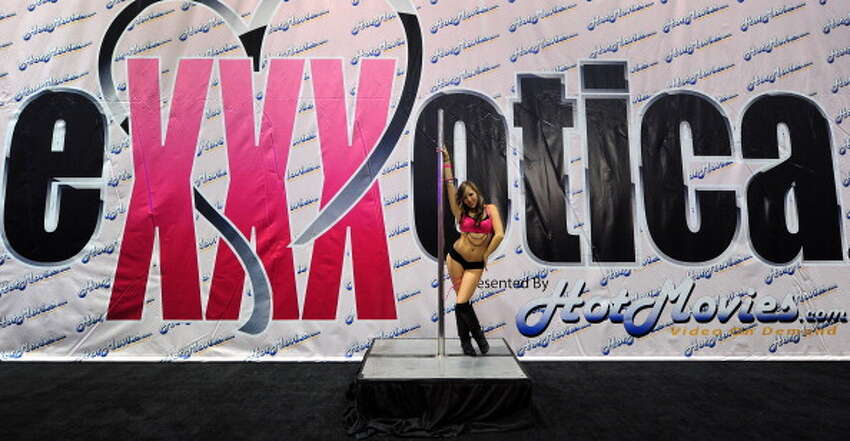 A pole dancer performs on opening day of the 2011 Exxxotica Expo on August 26, 2011 in Los Angeles, California. Exxxotica is one of the country's leading adult consumer events, featuring a diverse array of exhibitors showcasing the latest products appealing to like-minded adults, with seminars, stage shows and stars signing autographs for fans of the adult entertainment industry. AFP PHOTO/Frederic J. BROWN