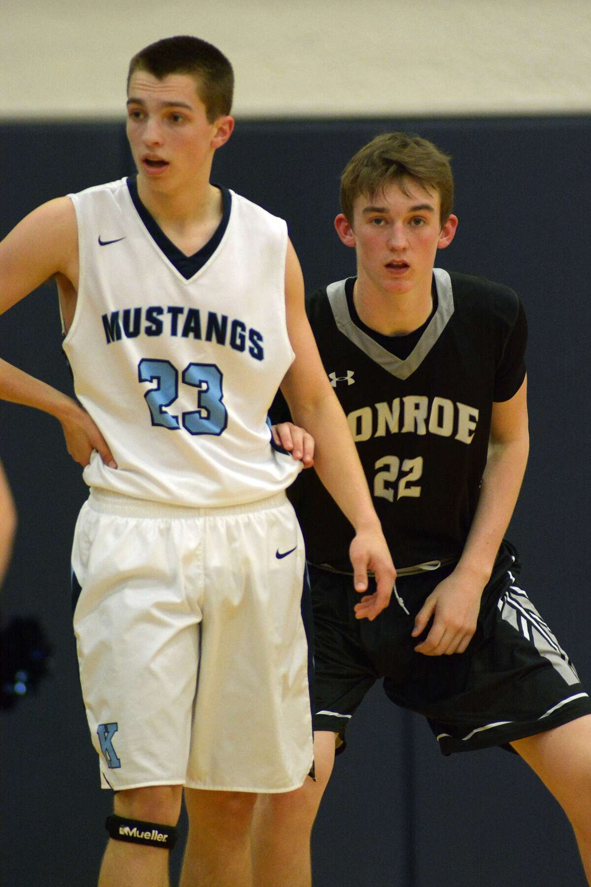 Conroe 6'1 junior guard Blaine Alger, right, plays defense against Kingwood 6'0 junior guard Matt Charles during their District 16-6A matchup at KHS on Feb. 5, 2016. (Photo by Jerry Baker/Freelance)