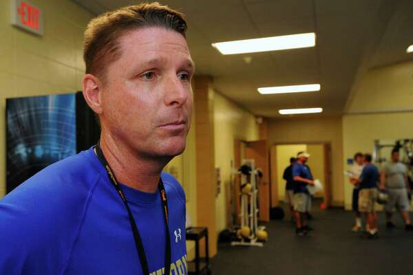 New Head Coach Kane Harris talks about his plans for his team. Hamshire-Fannett held one of their football practices Wednesday night, August 8, 2012 and started at 6 p.m.   Dave Ryan/The Enterprise