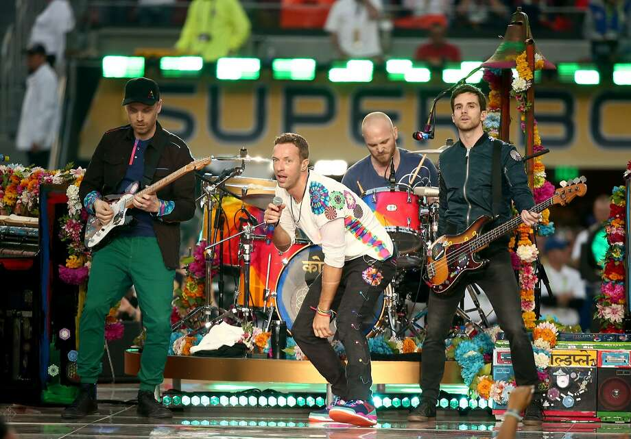 From left to right, Jonny Buckland, Chris Martin, Will Champion and Guy Berryman of Coldplay perform onstage during the Pepsi Super Bowl 50 Halftime Show at Levi's Stadium on February 7, 2016 in Santa Clara, California. Coldplay's request to extend Santa Clara's concert curfew was turned down. Photo: Christopher Polk