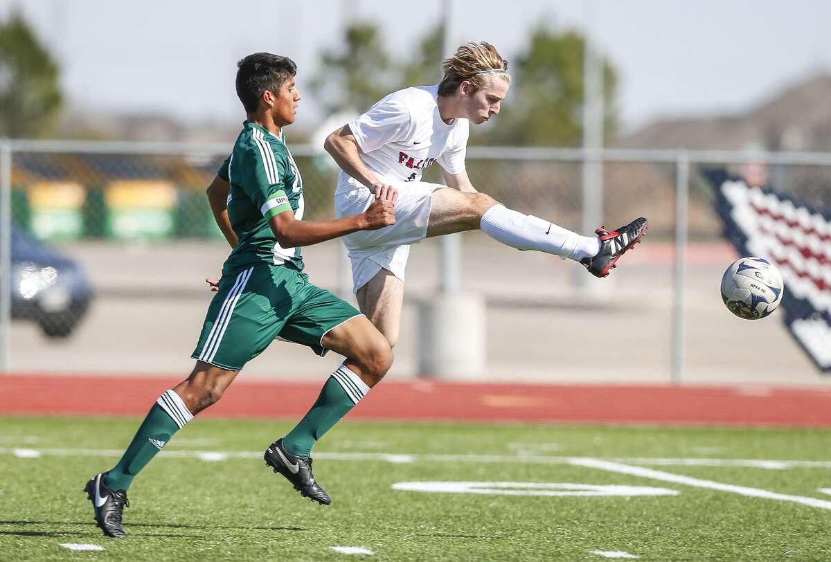Tompkins' Andre Staubo, right, goes for goal as Eid Yousef of Mayde Creek defends as the two teams drew 2-2 last weekend.