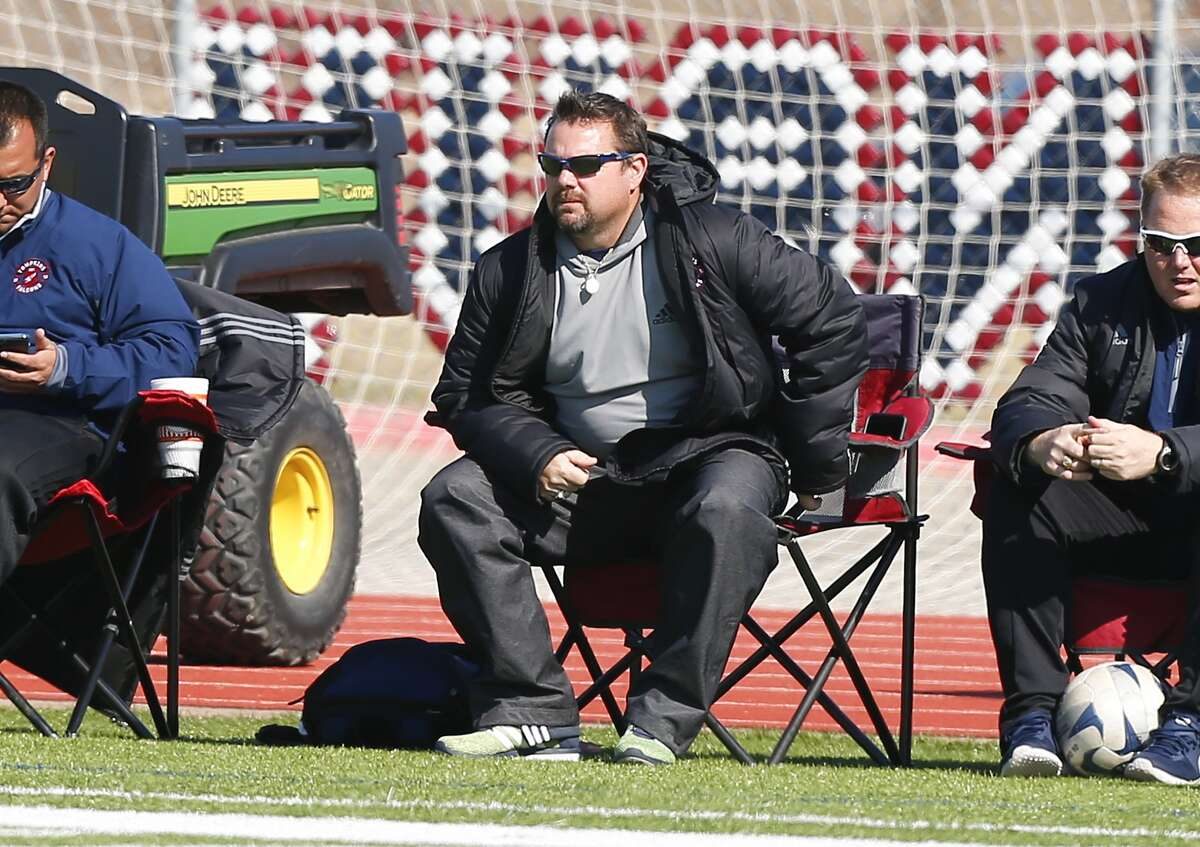 Tompkins boys soccer head coach Tom Jones watches the play unfold as the Falcons took on Mayde Creek as the two teams faced off in district play at Tompkins High School in Katy on February 6, 2015.