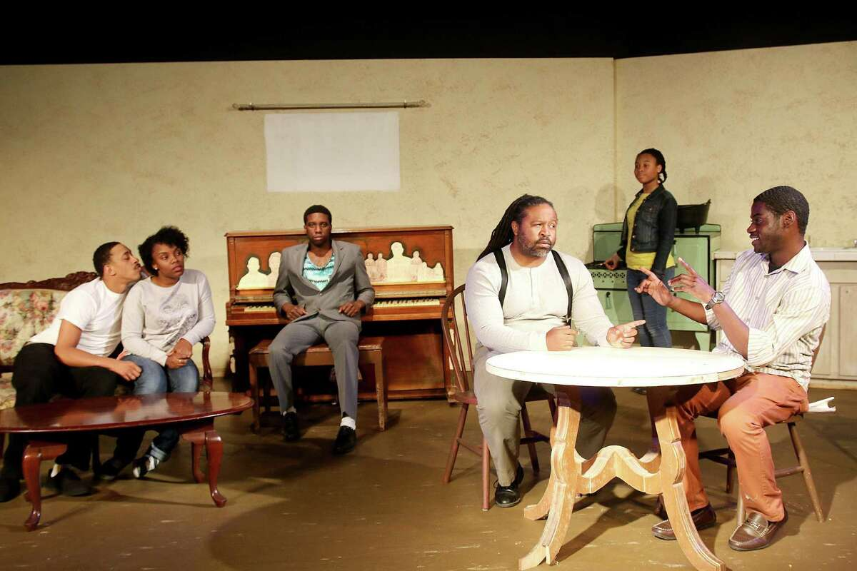 Ty Fisher, center at the table, portrays Doaker in the Pearl Theater production of