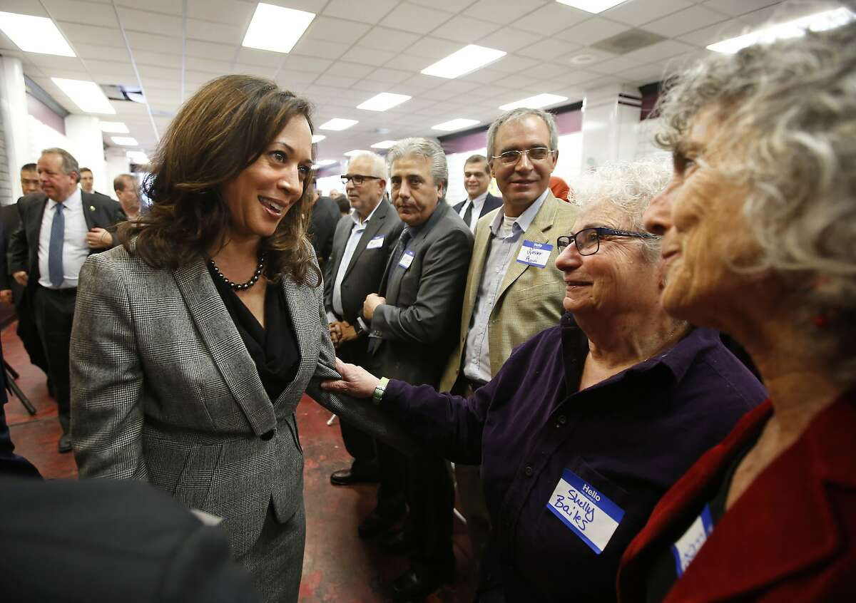 Attorney General Kamala Harris, left, a candidate for the U.S. Senate, talks with supporters Shelly Bailes, second from right, and Ellen Pontac, right, at a campaign gathering Thursday, Jan. 21, 2016, in Sacramento, Calif. Harris and Rep. Loretta Sanchez, D-Calif., hold the top two spots in the race to replace U.S. Senator Barbara Boxer. (AP Photo/Rich Pedroncelli)
