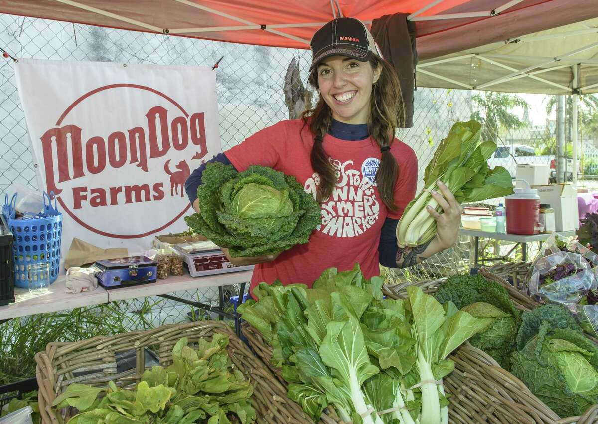 """Galveston's Own Farmers Market manager Casey McAuliffe shows off vegetables she grows at her farm, Moon Dog Farms. """"A lot of heads huddled together to make it happen,"""