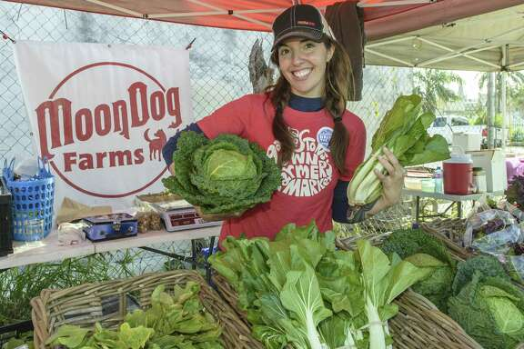 "Galveston's Own Farmers Market manager Casey McAuliffe shows off vegetables she grows at her farm, Moon Dog Farms. ""A lot of heads huddled together to make it happen,"" she said of the market at 2508 Post Office St. in Galveston, which occurs every Sunday."