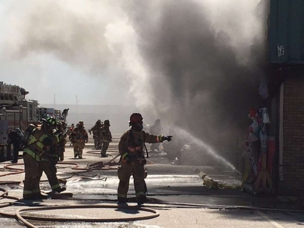 Houston Firefighters battle a three-alarm blaze at a warehouse located at 9895 Harwin on Tuesday, Feb. 9, 2016.