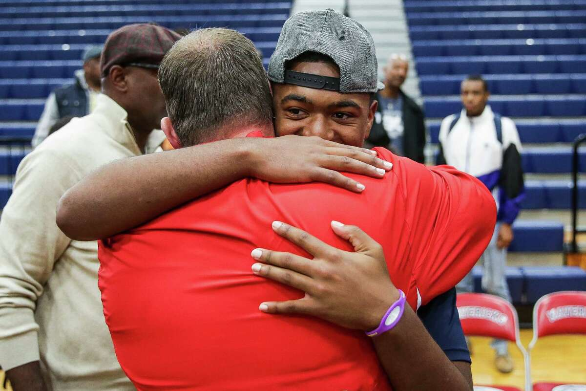 Manvel four-star safety Deontay Anderson received a tearful hug from head football coach Kirk Martin after Anderson announced that he had committed to play at Ole Miss during a high school national signing day ceremony last week.