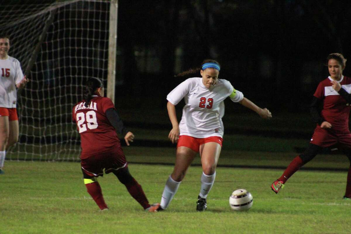 Number 23 for Lamar, Whitney Clark gets the ball out of the area vs Reagan at Lamar stadium.