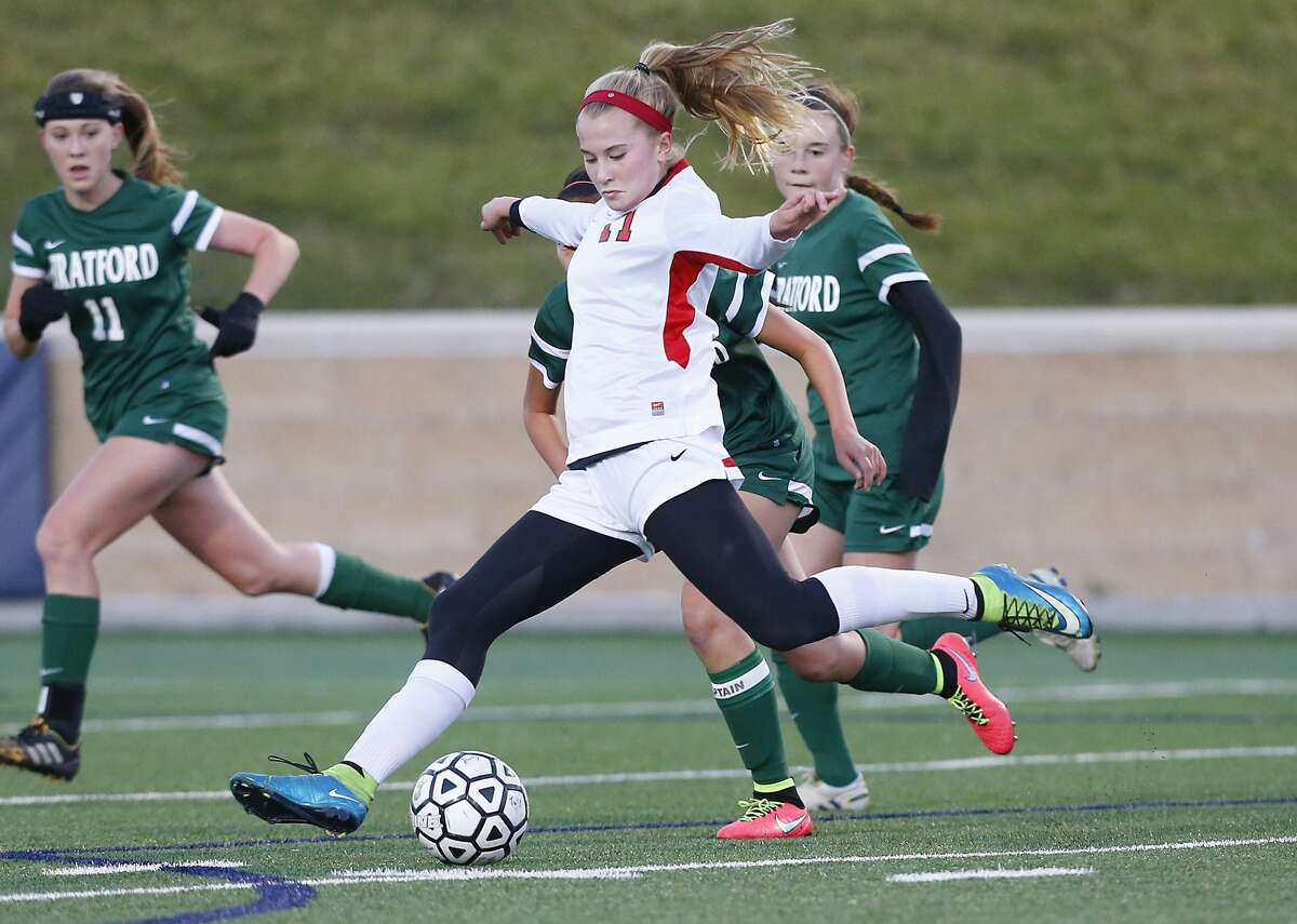 Grace Collins of Houston Memorial sets up a kick as the Lady Mustangs took on Stratford at Tully Stadium on January 22, 2016.