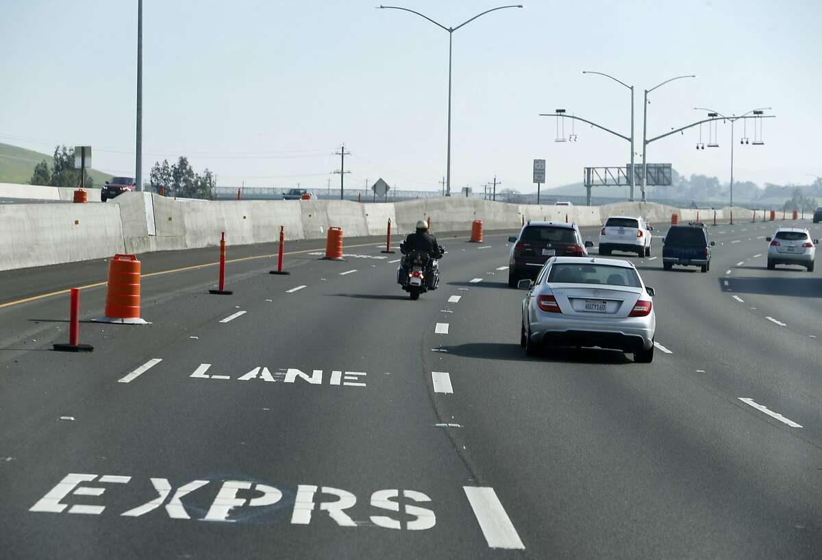 A CHP officer rides in an express lane on Interstate 580 in Livermore, Calif. on Tuesday, Feb. 9, 2016. The new lanes which may cost up to $13 for solo drivers to travel for the entire 14-mile corridor, is scheduled to open before the end of the month.