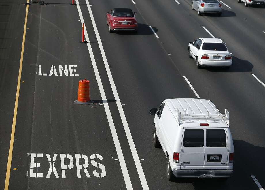 Commuters roll past express lanes on westbound Interstate 580 in Pleasanton, Calif. on Tuesday, Feb. 9, 2016. The new lanes which may cost up to $13 for solo drivers to travel for the entire 14-mile corridor, is scheduled to open before the end of the month. Photo: Paul Chinn, The Chronicle