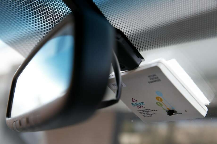 A FasTrak Flex transponder, equipped with a switch to set for the number of occupants for use on new Interstate 580 express lanes, is attached to a windshield in Pleasanton, Calif. on Tuesday, Feb. 9, 2016. Photo: Paul Chinn, The Chronicle