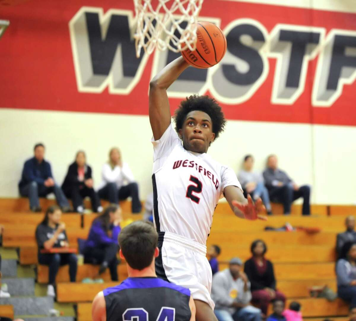 Westfield's Jase Pebres (2) rose high in order to slam dunk the ball in the win over Montgomery.
