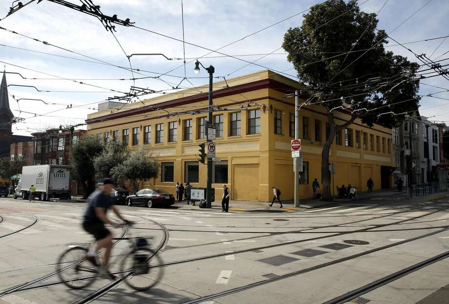 The yellow building at the corner of Church Street and Duboce Avenue is the proposed location of a new sex-offender clinic in San Francisco, California, on Tuesday, Feb. 9, 2016. Photo: Connor Radnovich, The Chronicle