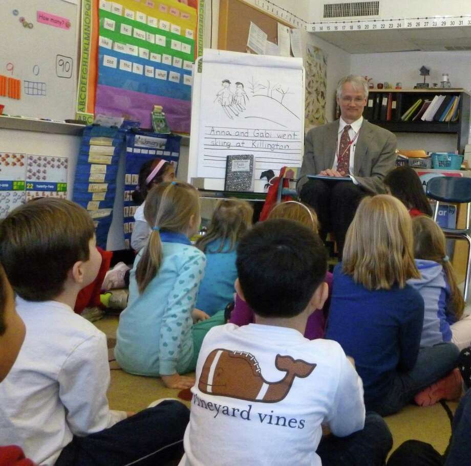 "Superintendent of Schools William McKersie read ""The Napping House,"" by Audrey Wood, to each of the International School at Dundee's three kindergarten classes, during a visit for the school's January Reading Challenge. Photo: Contributed Photo"