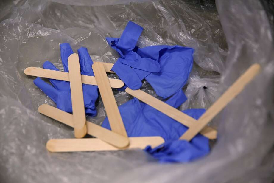 FILE — Discarded medical gloves and tongue depressors. Photo: Connor Radnovich, The Chronicle