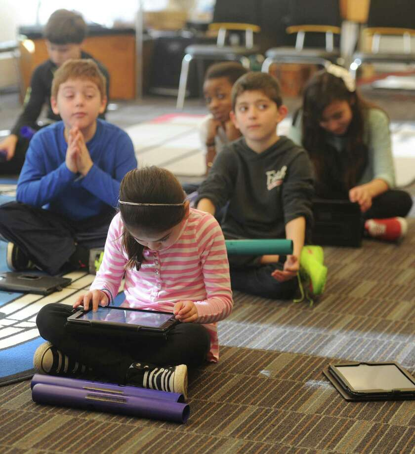The Greenwich school district's digital learning initiative has given every elementary student an iPad and every middle school and Greenwich High School student a Chromebook laptop. Photo: Tyler Sizemore / Tyler Sizemore / Greenwich Time