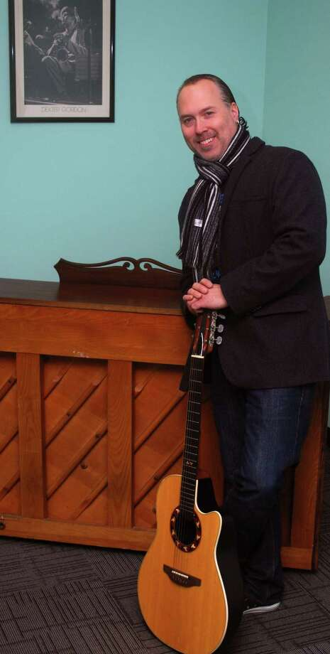 "New Milford High School graduate and professional musician Joseph ""Bearclaw"" Burcaw, who was most recently the bass player for Black 47, is embarking on a new chapter in his music career. He is opening Bearclaw's Academy of Music on Route 202 in New Milford. The business will offer one-on-one lessons in all orchestral instruments, percussion and vocals, as well as various programs and workshops. Photo: Deborah Rose / The News-Times"