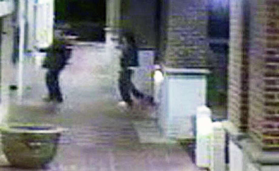 A video surveillance image shows a Lenox Jewelers employee, with an armed robbery suspect who had kidnapped him, entering Lenox Jewelers on Black Rock Turnpike as thieves stole millions in gems and other jewelry in April 2013. Photo: File Photo / File Photo / Fairfield Citizen