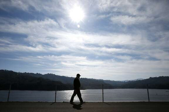 Michael Callow walks along the rim of Lafayette Reservoir in Lafayette, Calif. on Tuesday, Feb. 9, 2016, an activity he enjoys about three times a week. Unseasonally warm temperatures continue to provide a break from El Nino rainstorms throughout the Bay Area.