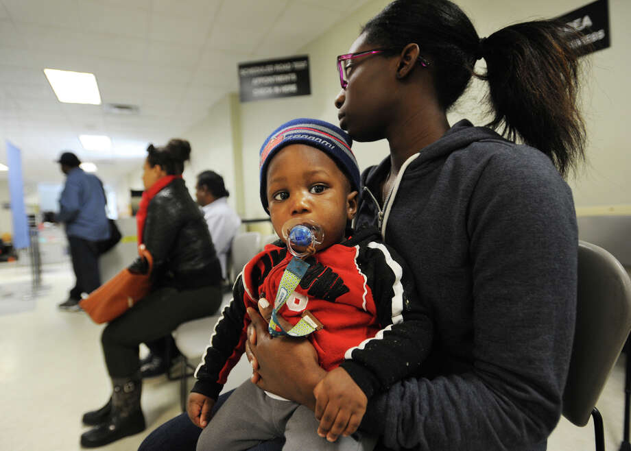 Allison Duncan, of Bridgeport, holds her son Duncan, 15 months, as she waits to take her driver's license test at the Department of Motor Vehicles in Bridgeport, Conn. on Tuesday, February 9, 2016. Photo: Brian A. Pounds, Hearst Connecticut Media / Connecticut Post