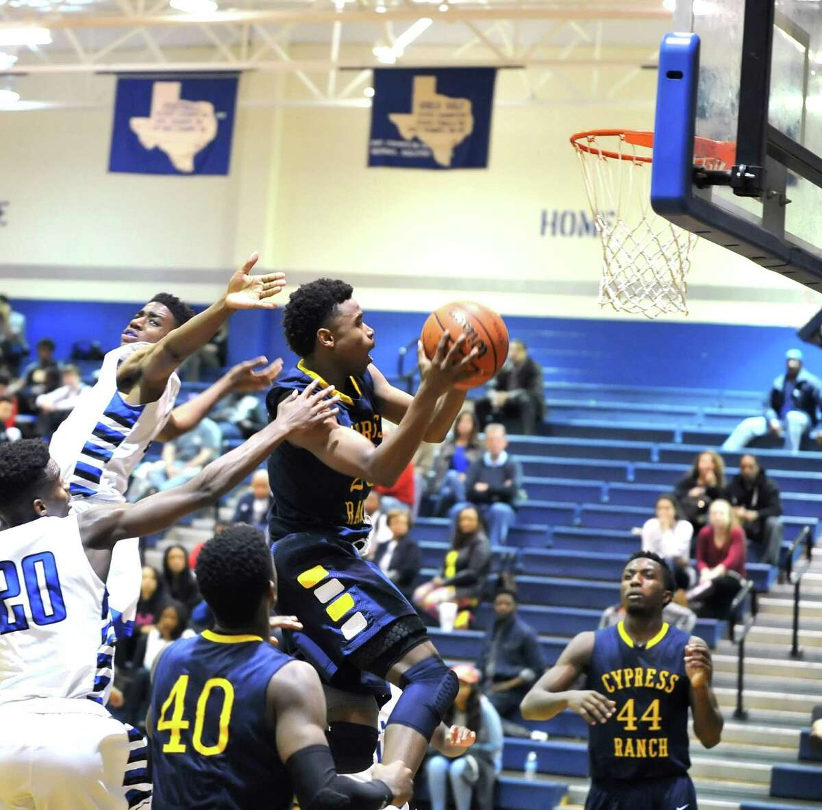 Cy Ranch and Cy Creek boys basketball teams played a game at the Cy Creek gym, 2-5-2016. Cy Ranch won the game, 56-43. Cy Ranch guard Michael Tate (23) scored on a layup in the third quarter against Cy Creek.