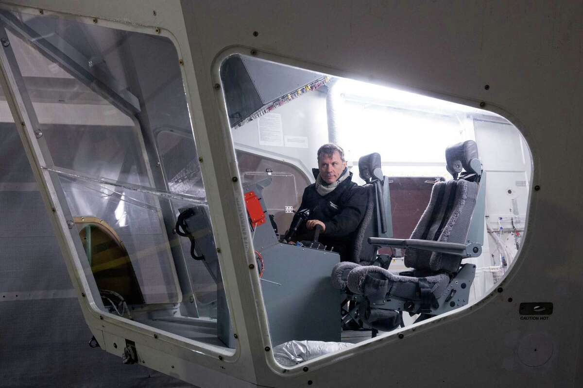 Bruce Dickinson, the lead singer of the band Iron Maiden, sits at the controls on the flight deck of the helium-filled Airlander aircraft in a giant airship shed on February 28, 2014 in Cardington, England. The Airlander, which was originally developed for the US military before the project was cancelled due to budget cuts, is the world's longest aircraft at 92 meters. Although slow moving compared to conventional aircraft, the Airlander is able to carry large payloads over long distances very efficiently. Hybrid Air Vehicles' project to develop the technology further is being funded by a government grant as well as private finance from individuals including Bruce Dickinson, the lead singer of the band Iron Maiden.