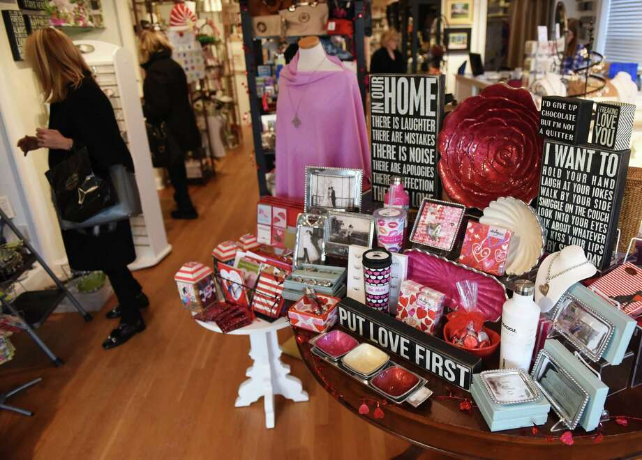 Customers browse a large selection of Valentine's Day gifts for sale at Splurge gift shop in Greenwich, Conn. Tuesday, Feb. 9, 2016. Photo: Tyler Sizemore / Hearst Connecticut Media / Greenwich Time