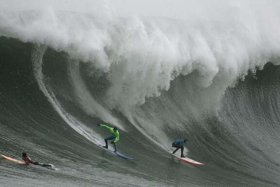 FILE - In this Jan. 12, 2008, file photo, Greg Long, left, and Jamie Sterling surf a giant wave during the Mavericks surf contest in Half Moon Bay, Calif. The world's best big-wave competition, Titans of Mavericks has been set for Friday, Feb. 12, 2016. Mavericks is the world's premiere, high adrenaline, big wave surfing event is a one-day invitation-only surfing competition that is held at the legendary Mavericks surf break located near Half Moon Bay, about 20 miles south of San Francisco. (AP Photo/Ben Margot)