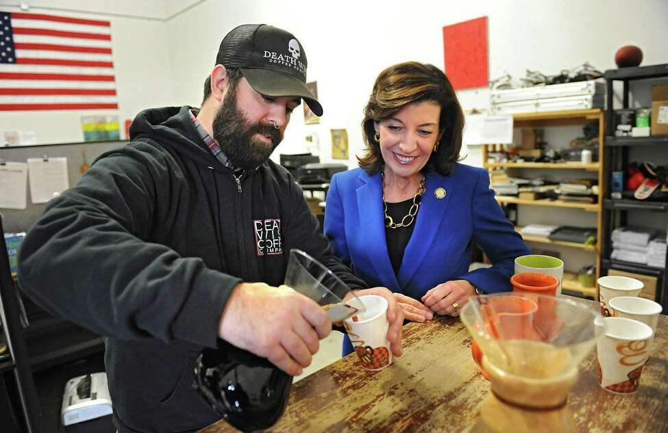 Death Wish Coffee shipping manager Eric Donovan, left, pours a cup of coffee for Lieutenant Governor Kathy Hochul as he gives her a tour of Death Wish Coffee company following their Super Bowl ad debut on Tuesday, Feb. 9, 2016 in Round Lake, N.Y. (Lori Van Buren / Times Union)
