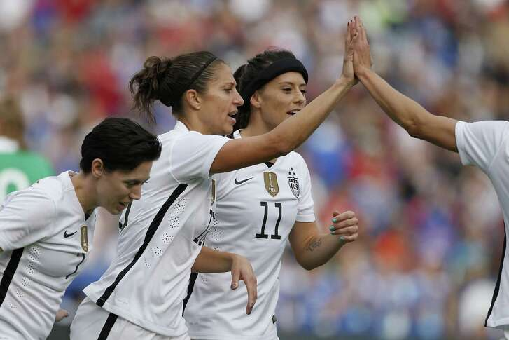 SAN DIEGO, CA - JANUARY 23:  Carli Lloyd #10 of the United States is congratulated by her teammates after scoring a goal as the United States defeated Ireland 5-0 at Qualcomm Stadium on January 23, 2016 in San Diego, California.  (Photo by Todd Warshaw/Getty Images)