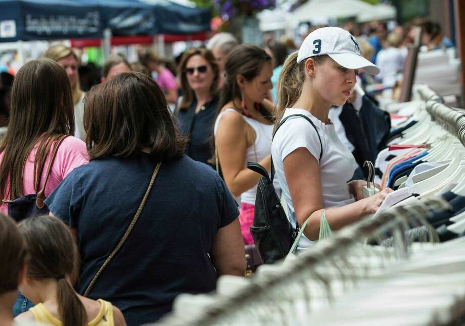 Downtown New Canaan merchants would be able to start sidewalk sales on Friday, July 15, the day before the 50 th  anniversary version of the annual event Photo: Mark Conrad / Mark Conrad / Connecticut Post Freelance