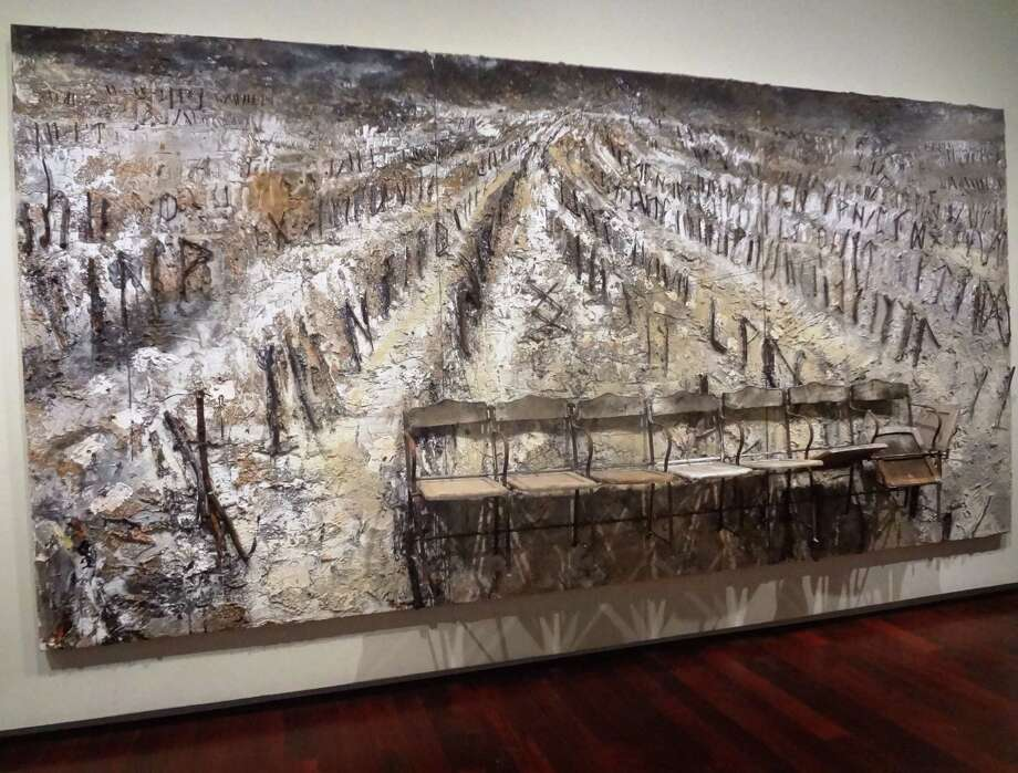 """Renowned German artist Anselm Kiefer's monumental 2006 untitled work of charcoal, chairs, branches and plaster on canvas is the centerpiece of """"Made in Germany."""" Photo: Steve Bennett / Express-News"""