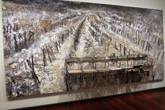 "Renowned German artist Anselm Kiefer's monumental 2006 untitled work of charcoal, chairs, branches and plaster on canvas is the centerpiece of ""Made in Germany."""