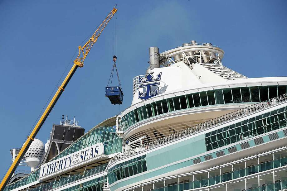 A crane loads cargo on the Royal Caribbean's Liberty of the Seas cruise ship as it sits in port on Sunday , February 7, 2016 in the Port of Galveston in  Galveston, Texas. Photo: Thomas B. Shea, For The Chronicle / © 2016 Thomas B. Shea