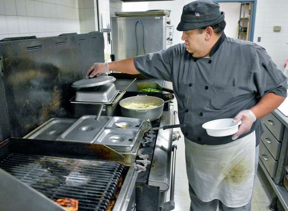 Chef Tito Alejandro in the kitchen at Blessings Cafe in the Albany diocese's Pastoral Center Friday Feb. 5, 2016 in Albany, NY.  (John Carl D'Annibale / Times Union) Photo: John Carl D'Annibale / 10035297A