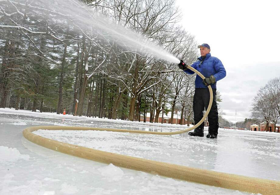 Saratoga Spa State Park employee Dan Urkevich of Mechanicville uses a hose to spray water on the skating rink at the Saratoga Spa State Park Tuesday, Feb. 9, 2016 in Saratoga Springs, N.Y. (Lori Van Buren/Times Union) Photo: Lori Van Buren / 10035338A