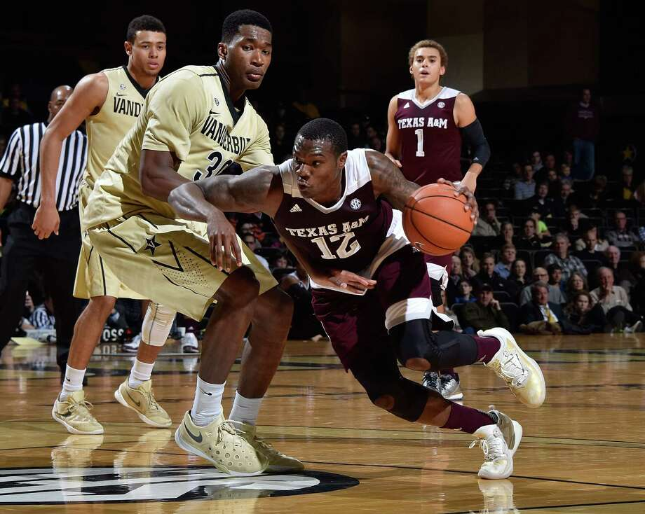 Jalen Jones of the Texas A&M Aggies drives into Damian Jones of the Vanderbilt Commodores during the first half at Memorial Gym on Feb. 4, 2016 in Nashville, Tenn. Photo: Frederick Breedon /Getty Images / 2016 Getty Images