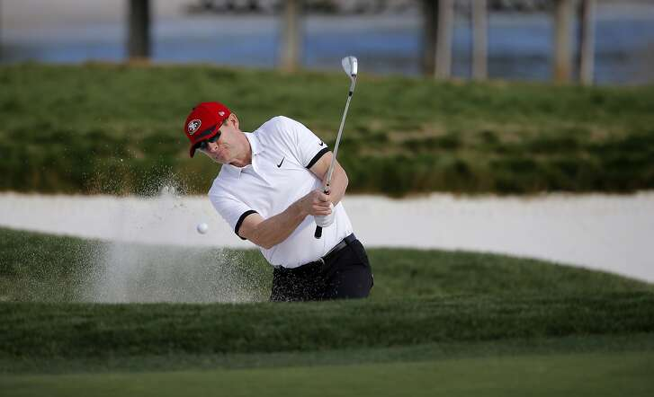 Former 49ers quarterback Steve Young, hits out of the green side bunker on the seventeenth hole  as teams from San Francisco Giants and the San Francisco 49ers square off in the Chevron Shoot-out for charity during the AT&T Pebble Beach Pro-Am, in Pebble Beach, California on Tues. February 9, 2016.