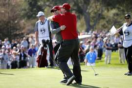 Former 49ers quarterback Steve Young, (left) and Dwight Clark celebrate winning the first hole, as teams from San Francisco Giants and the San Francisco 49ers square off in the Chevron Shoot-out for charity during the AT&T Pebble Beach Pro-Am, in Pebble Beach, California on Tues. February 9, 2016.