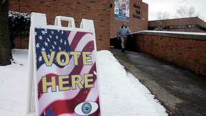 A voter leaves the Albany High School as voting took place on the multimillion-dollar proposal to rebuild and expand the city's public high school on Tuesday, Feb. 9, 2016, in Albany, N.Y.   (Paul Buckowski / Times Union)