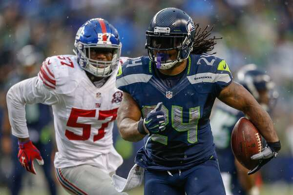 SEATTLE, WA - NOVEMBER 09: Running back Marshawn Lynch #24 of the Seattle Seahawks rushes against linebacker Jacquian Williams #57 of the New York Giants at CenturyLink Field on November 9, 2014 in Seattle, Washington. The Seahawks defeated the Giants 38-17. (Photo by Otto Greule Jr/Getty Images)