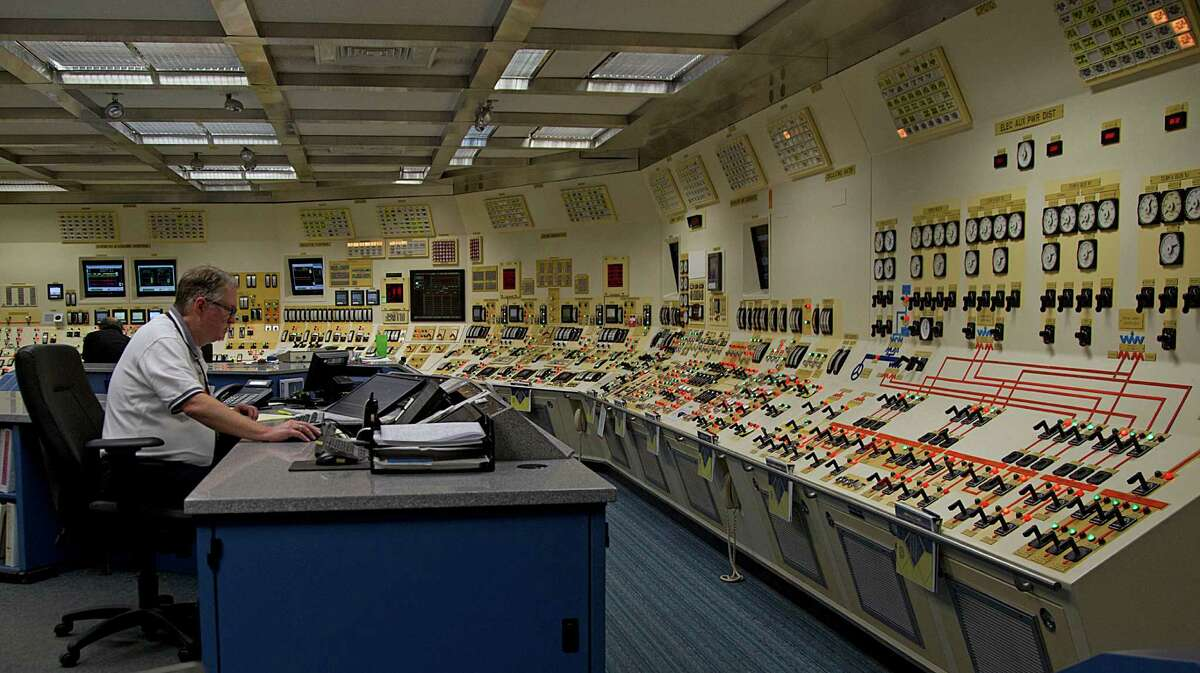 An operator works in the control room of Unit 1 at the South Texas Project nuclear power facility in Wadsworth. Plant owners won federal approval for two new reactors, but construction seems unlikely.