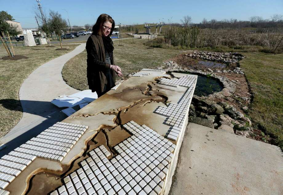Anne Olson, president of the Buffalo Bayou Partnership, shows how bayou water will flow from a solar-powered cistern into wetlands at Buffalo Bend Nature Park. Photo: Gary Coronado, Staff / © 2015 Houston Chronicle
