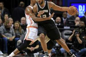 Spurs take first game of rodeo trip, rout Heat - Photo